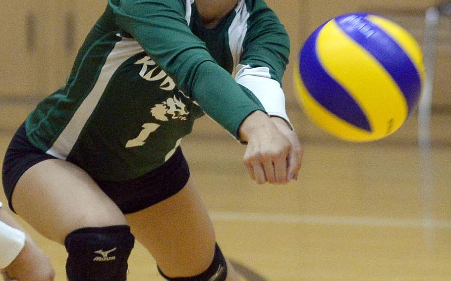 Kubasaki's Anya Andrade tries to field a Seisen spike during Saturday's Dragons' three-set win over the Phoenix for the YUJO IV tournament title.