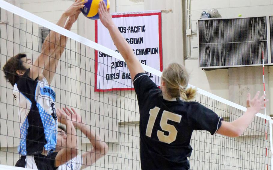 Humphreys' Kieran Blessing and Osan's MinSung Kim go up at the net for the ball during the Blackhawks' four-set win over the Cougars.