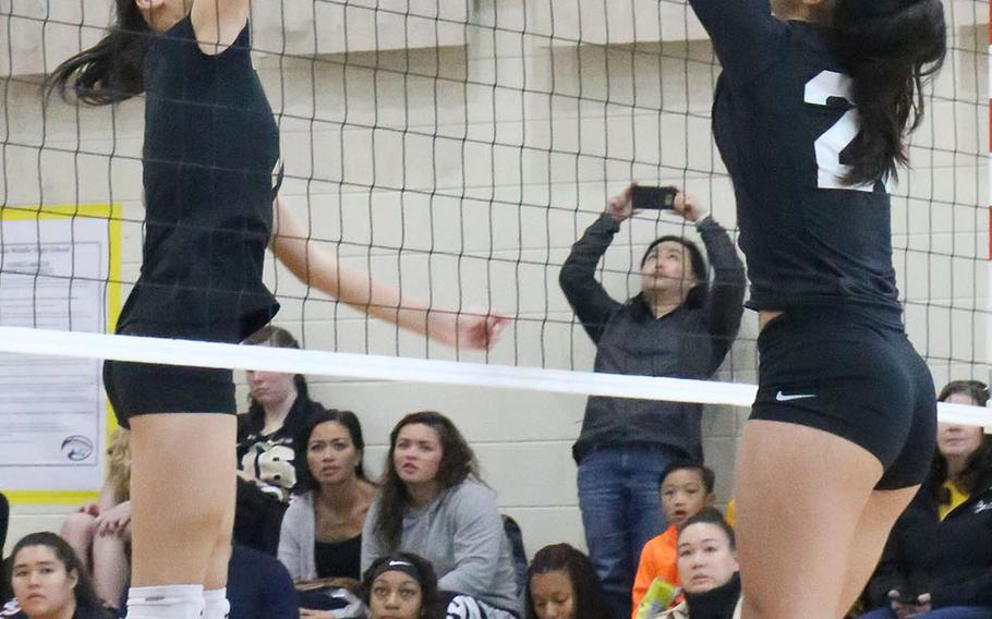 Humphreys' Ariel Stickar and Osan's Maja Inthavixay battle at the net for the ball during the Cougars' three-set win Saturday over the Blackhawks.