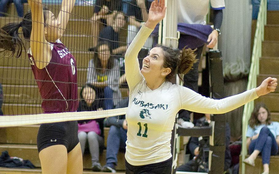 Kubasaki's Donatella Barone and Seisenl's Sarah Atanacio nearly collide at the net over the ball during Saturday's Dragons' three-set win over the Phoenix for the YUJO IV tournament title.