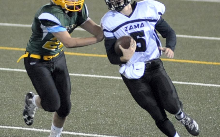 Zama quarterback Nick Cannon Canada tries to outrun Eagles defender Tyler Clarkson.