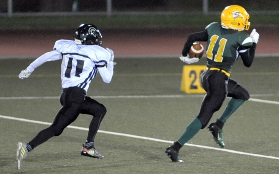 Eagles receiver A.J. Nelson outruns Trojans defender Justyn Seraphin to the end zone with one of his three touchdown catches.