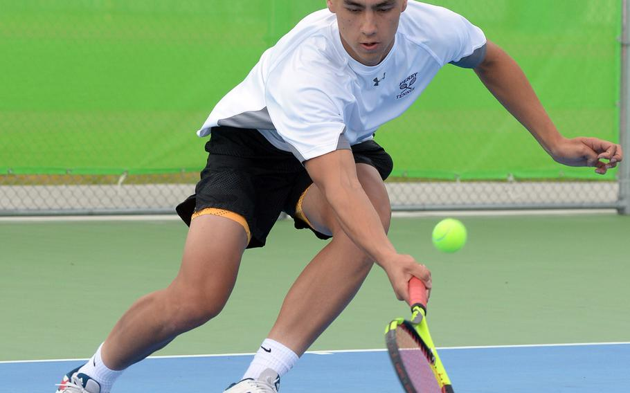Matthew C. Perry's Kai Lange plays a ground stroke during his 8-0 loss Friday to Nile C. Kinnick's Daniel Posthumus in the DODEA-Japan tennis tournament.