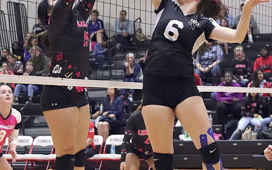 Zama's Aurelia Young flicks the ball past Nile C. Kinnick's Tori Osterbrink during Friday's five-set win by the Trojans over the Red Devils in DODEA Japan girls volleyball tournament.
