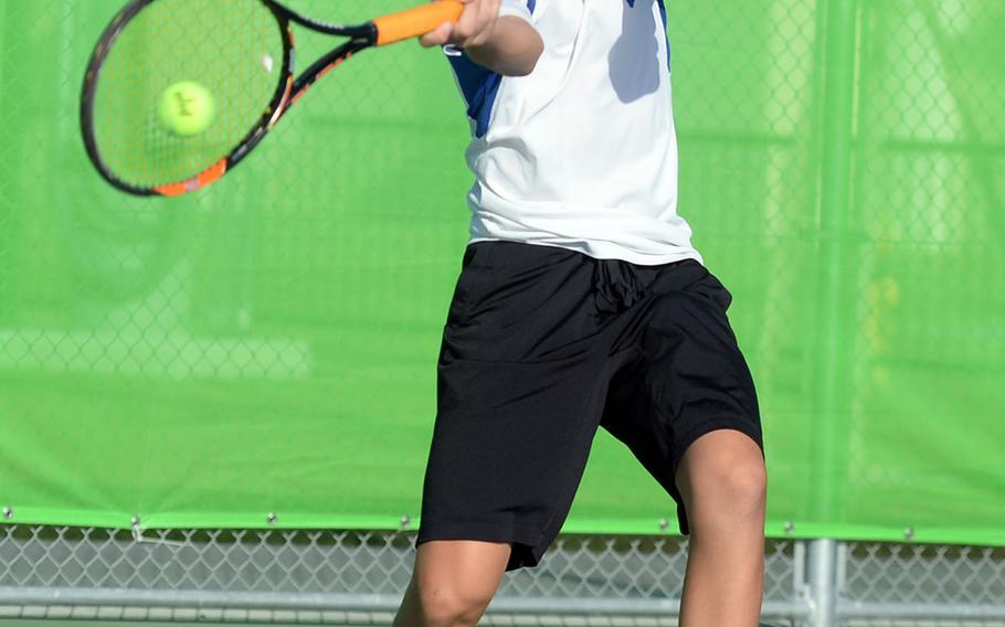 Yokota freshman Kai Deremer smacks a forehand return against E.J. King's Takumi Kodama during Saturday's boys singles A final in the DODEA-Japan tennis tournament. Deremer won 9-7.