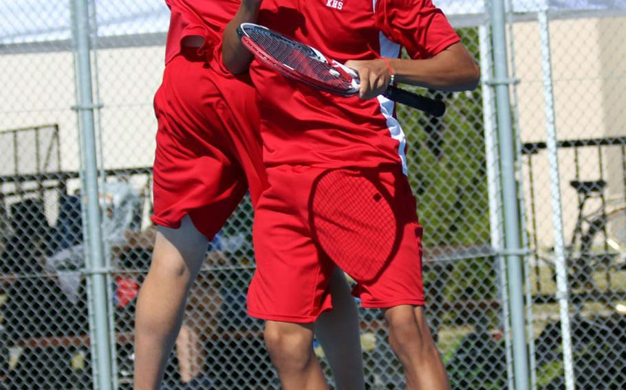 Nile C. Kinnick's Daniel Posthumus and Matthew Manson celebrate following a point during during Saturday's boys doubles final in the DODEA-Japan tennis tournament. They lost to E.J. King's Takumi Kodama and Johnathon Lee for the title.