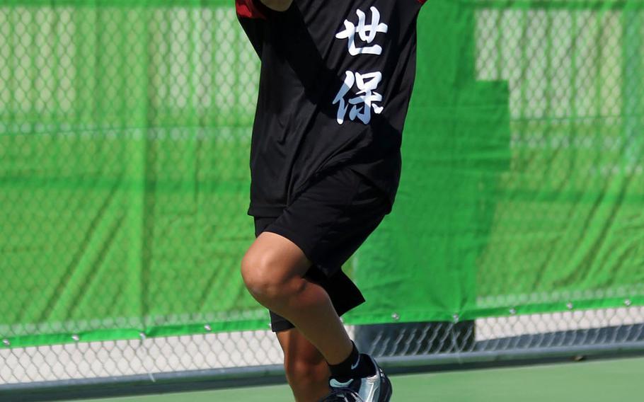 E.J. King's Takumi Kodama hits a forehand return during Saturday's boys doubles final in the DODEA-Japan tennis tournament. Kodama and teammate Johnathon Lee beat Nile C. Kinnick's Daniel Posthumus and Matthew Manson for the title.