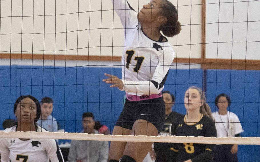 Kadena's Brie Barnett goes up to spike at the net against Urasoe Kogyo during Saturday's action in the Okinawa-American Volleyball Festa at Kadena Air Base's Risner Fitness Center. The Panthers won 25-8, 25-11.