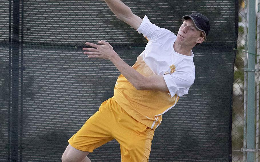 Kadena's Brett Davis hits an overhand return during Tuesday's singles and doubles matches with Kubasaki. Davis won his singles tie 6-2 over Henry Ruksc and teamed with Royce Smola to beat Ruksc and Max Weidley 6-4.