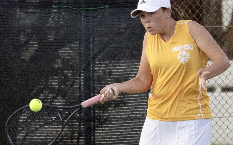 Kadena's Lisa Dombrowski smacks a forehand return during Tuesday's singles and doubles matches with Kubasaki. Dombrowski lost her singles tie 6-2 to Ally Johnson, but teamed with Maddie Tsirlis to beat Carolina Rivera and Nancy Gutzwiller 6-3 in doubles.