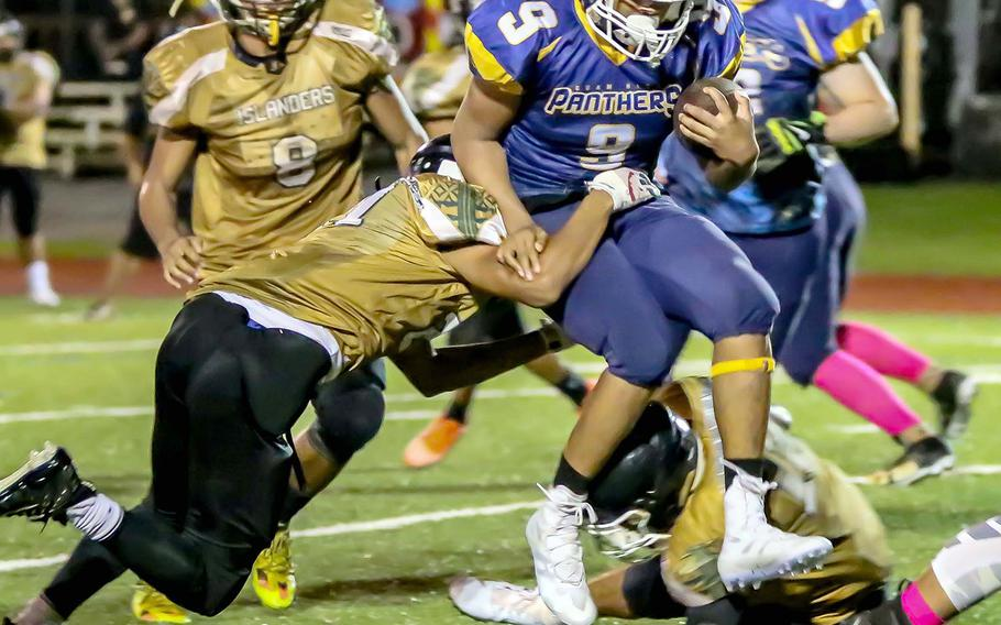 Guam High's RaSean Jacobs gets bottled up by John F. Kennedy's defense.