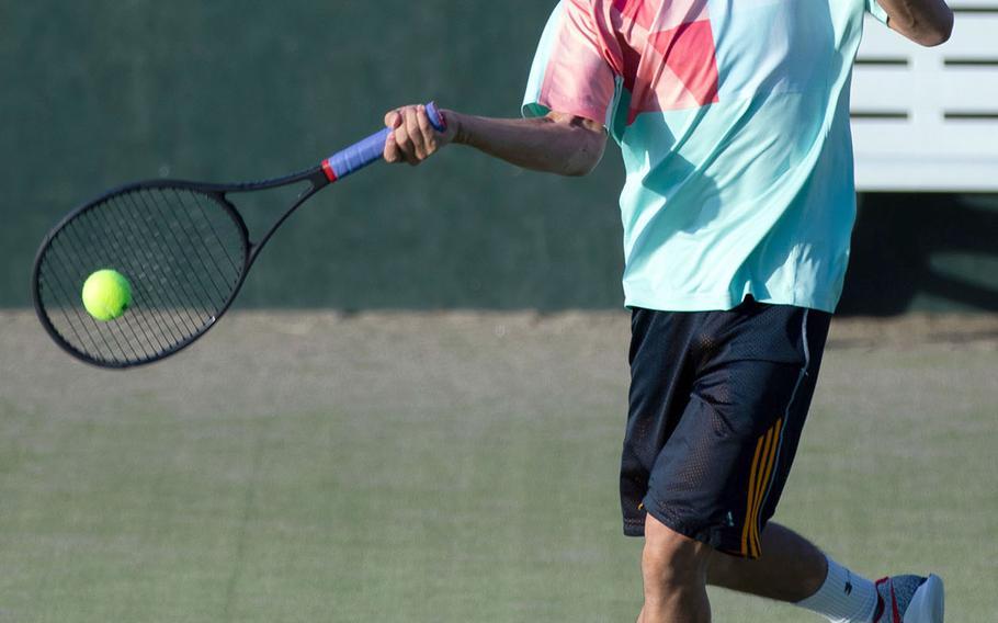 ASIJ's Joshua Inahara rips a forehand return during his two-set singles finals sweep of YIS' Arten Yekeh Yazdandoost.