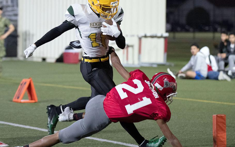Edgren receiver A.J. Nelson tries to make for the corner of the end zone ahead of Kinnick defender Justice Jackson.