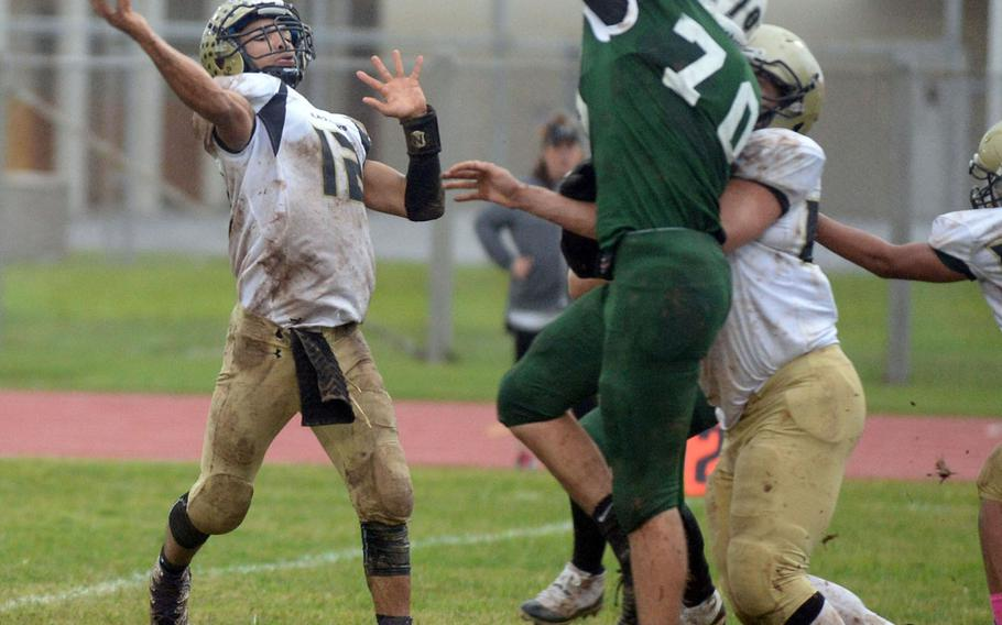 Humphreys quarterback Miles Brice launches a pass over the outstretched hand of Kubasaki defender Lucas Kappen.