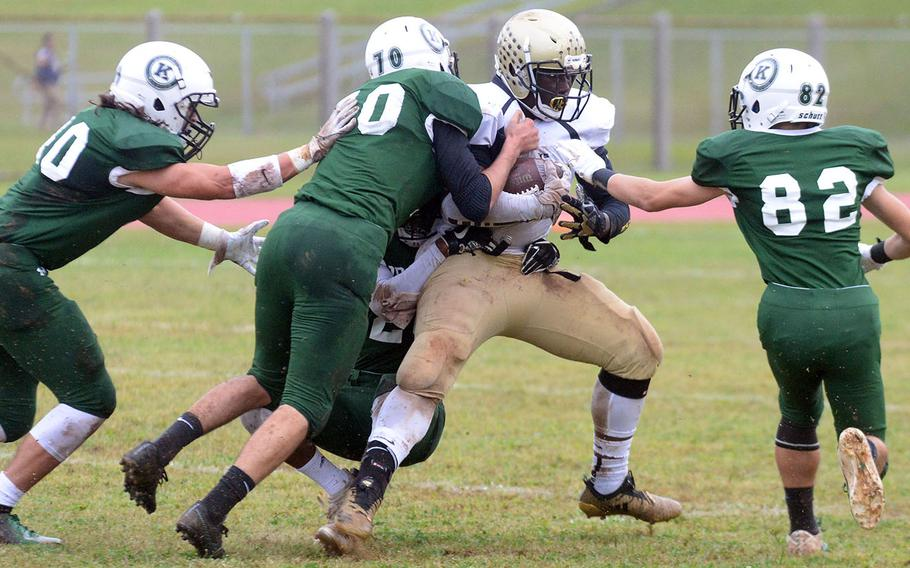 Humphreys' David Key gets surrounded by a swarm of Kubasaki defenders: Hayden Williamson, Lucas Kappen and Nick Cooper. Key led all ball carriers with 125 yards on 18 carries.