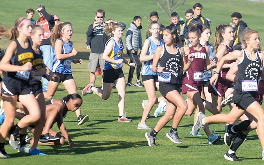 Matthew C. Perry's Angelique Armijo, right, leads the pack from the start of Monday's Far East girls race as one runner stumbles in the middle of the course.
