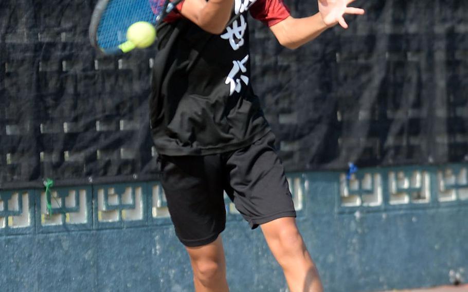E.J. King's Takumi Kodama rips a forehand return during Wednesday's boys singles play in the Far East tennis tournament. Kodama beat Kubasaki's Kai Grubb and Matthew C. Perry's William Rudolph by 8-2 scores to reach the quarterfinals.