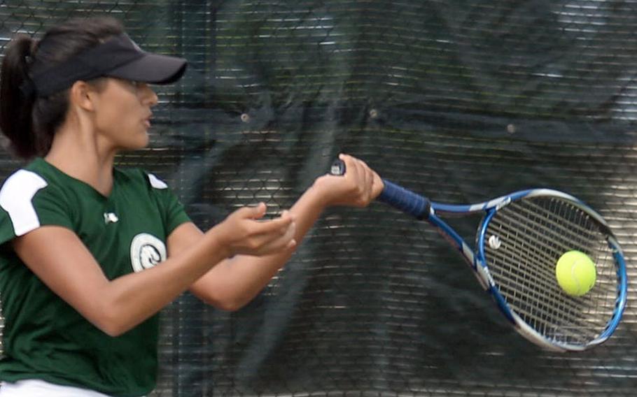 Kubasaki's Ally Johnson smacks a forehand return during Wednesday's girls singles play in the Far East tennis tournament. Johnson beat Seoul American's Ashley Kim 8-3 and Kinnick's Jillian Mock 8-1 to reach the quarterfinals.