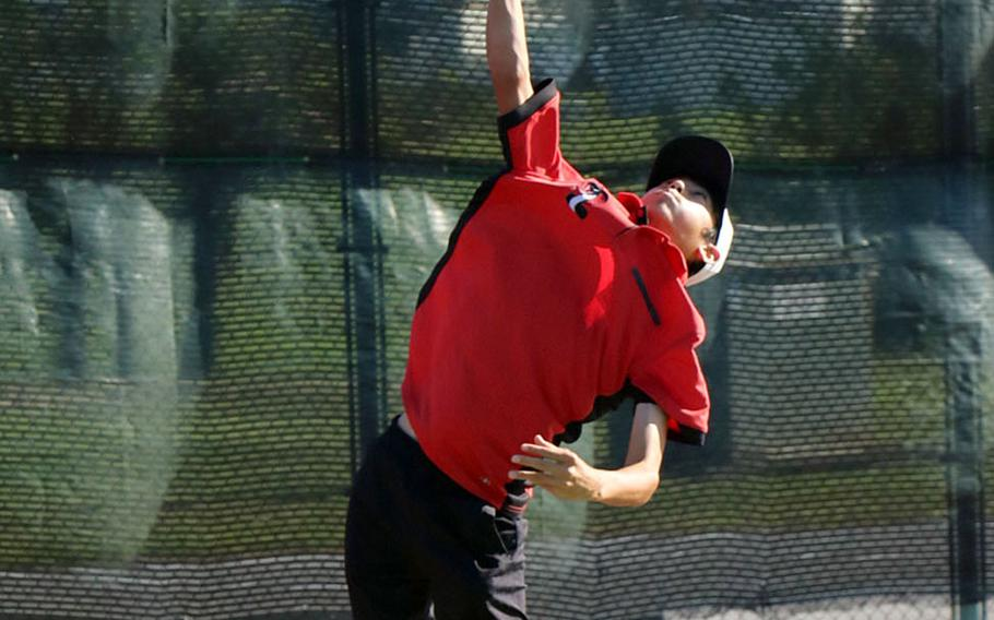 E.J. King's Takumi Kodama readies a serve during his Far East singles quarterfinals win Thursday over Ian Choi of Yongsan.