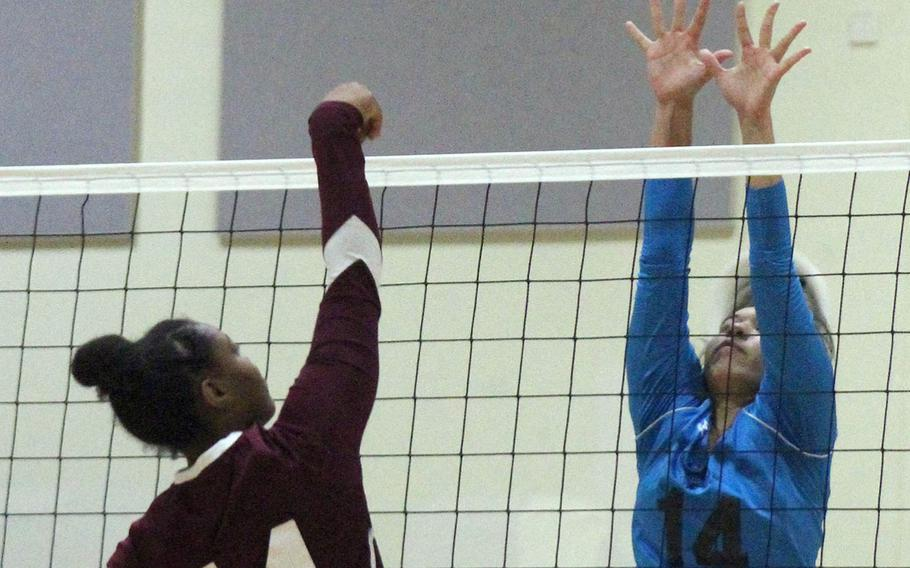 Osan's Maja Inthavixay goes up to block a spike by Perry's Taniya Smith during the Cougars' two-set win over the Samurai on Day 1 of the Far East Division II Tournament.