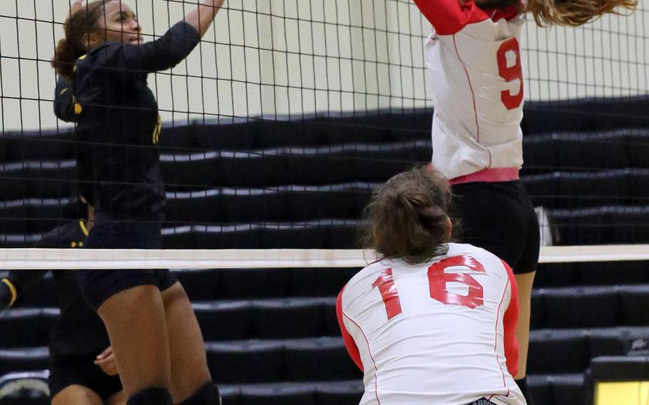 Kadena's Brie Barnett and Kinnick's Melissa Rose battle for the ball at the net during Friday's elimination match in the Far East Division I girls volleyball tournament. The Red Devils beat the Panthers in three sets.