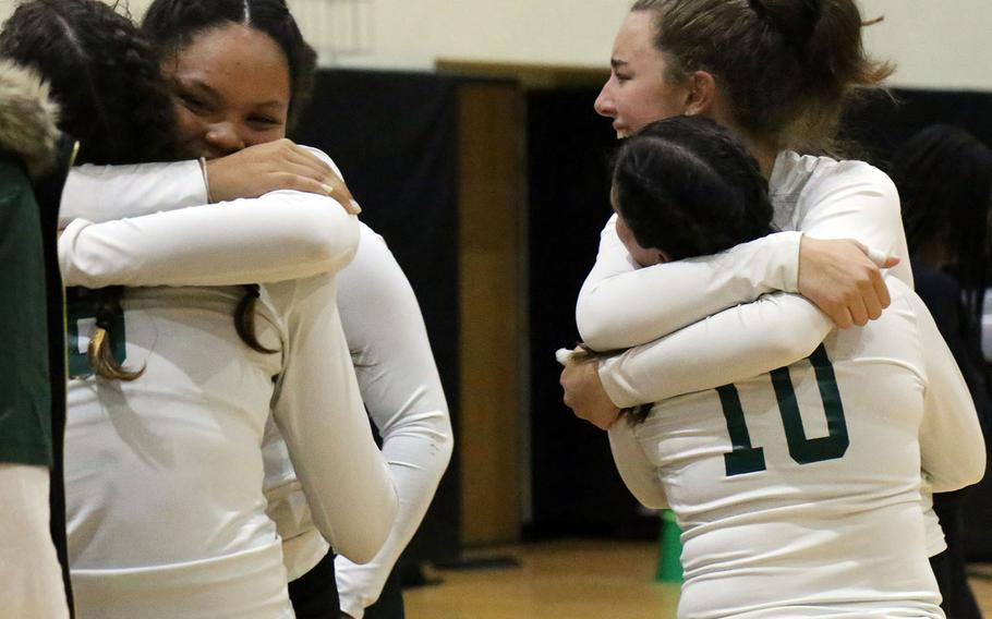 Kubasaki players celebrate their Far East Division I girls volleyball championship and their fourth in five seasons.