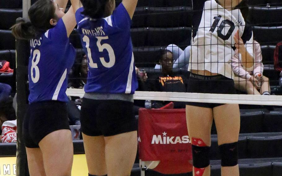 Zama's Leah Sakamoto-Flack tries to hit the ball through a pair of Christian Academy Japan defenders.