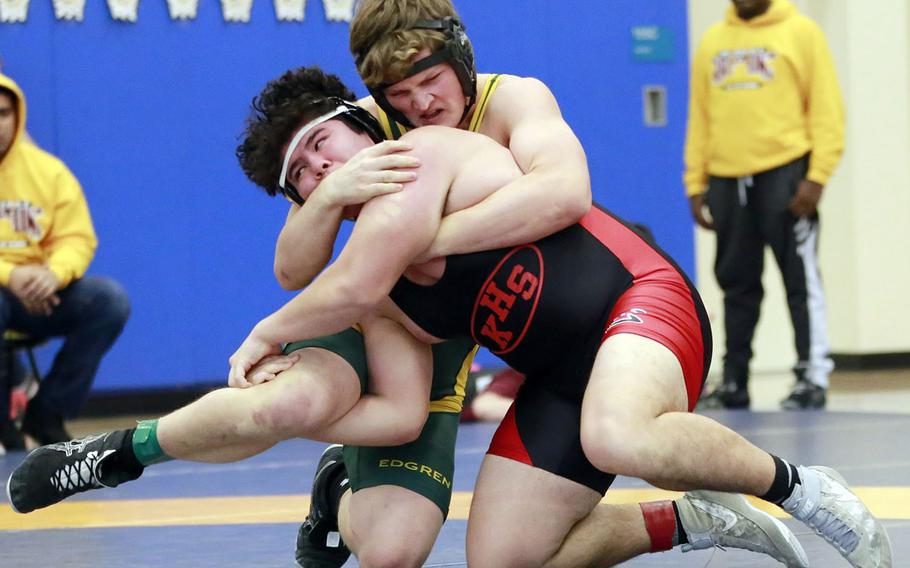 Nile C. Kinnick's Chris Mason and Robert D. Edgren's Chase Quigley grapple for the upper hand during Saturday's Japan dual-meet tournament at Yokota. Mason won by decision and the Red Devils won the dual meet 32-24.
