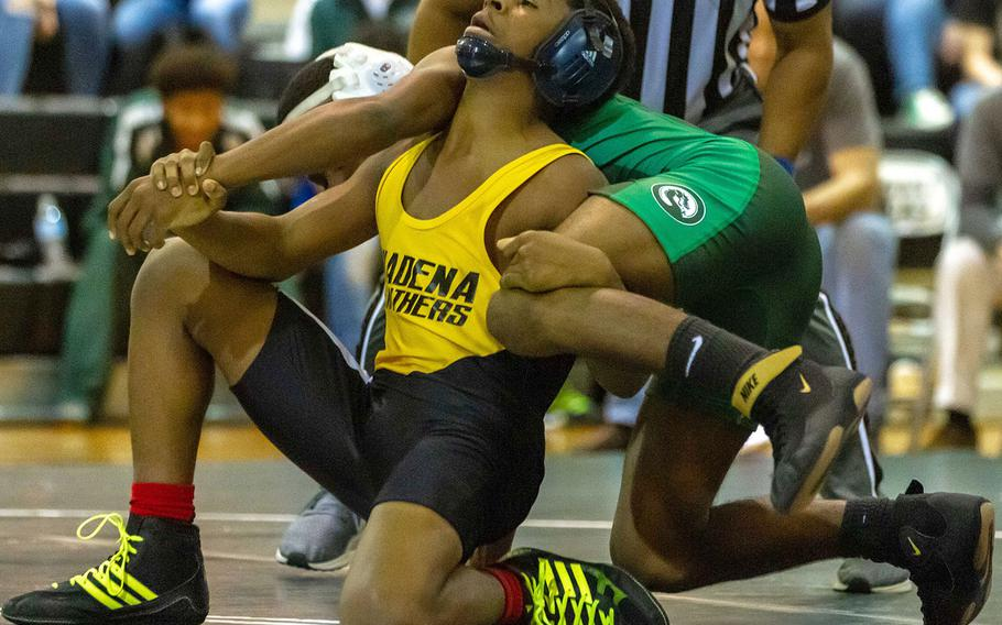 Kadena's Crisean Covington tries to lift Kubasaki's Jaylan Mayers in the 122-pound bout during Wednesday's Okinawa wrestling dual meet. Mayers won by technical fall 10-0 in 1 minute, 58 seconds, and the Dragons won the dual meet 42-18.
