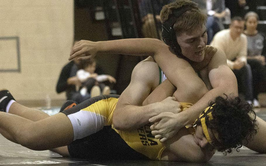 Kubasaki's Oakley Mueller gets the upper hand on Kadena's Fintan Cawley in the 168-pound bout during Wednesday's Okinawa wrestling dual meet. Mueller won by in in 2 minutes, 42 seconds and the Dragons won the meet 42-18.