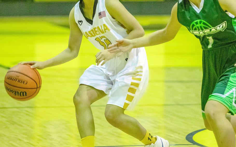 Kadena's Mary Clair Santos dribbles upcourt against Kubasaki during Friday's Okinawa girls basketball game. The Panthers won 46-14 to clinch their 14th straight district title over the Dragons.