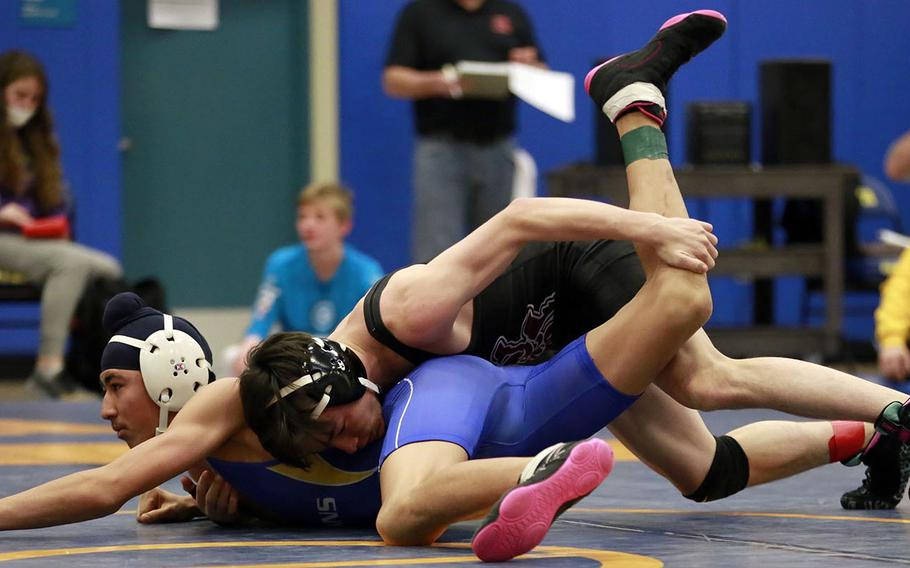 Matthew C. Perry's Brad Ponsiano gains the upper hand on St. Mary's Jasjot Bedi in the 122-pound final of Saturday's Yokota Invitational Basketball Tournament. Bedi rallied to pin Ponsiano in 2 minutes, 4 seconds.