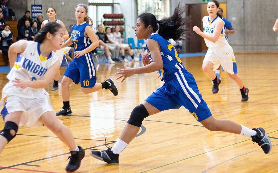 Yokota freshman Alexis Smalls drives to the basket against Christian Academy Japan during Saturday's Japan girls basketball game. The Panthers won 24-15.