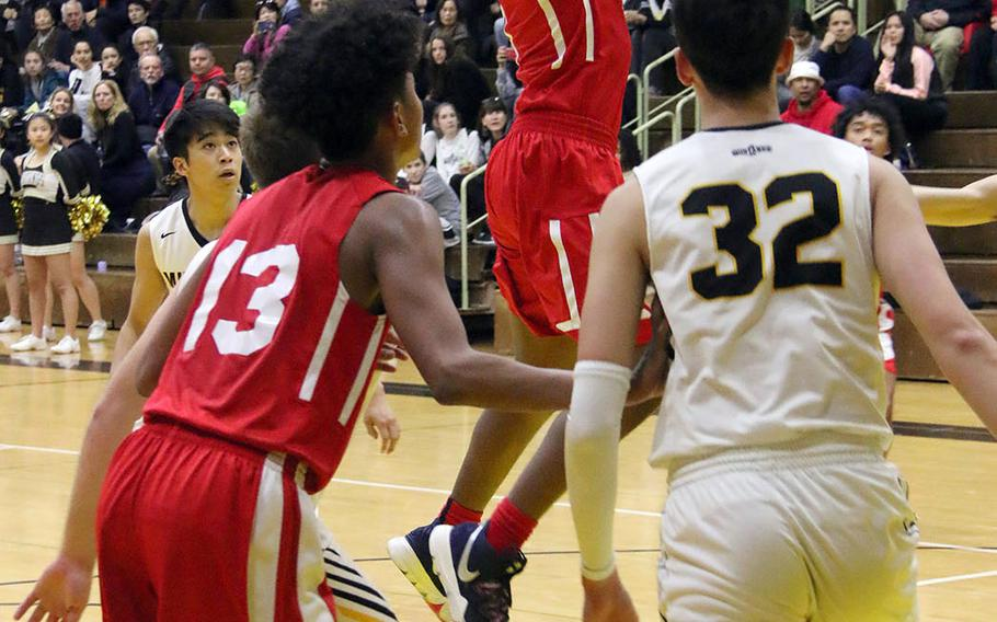 Nile C. Kinnick's Rodrick Bell shoots against American School In Japan during Saturday's rematch of last year's Far East Division I and combined tournament finals. The defending D-I champion Red Devils edged the defending combined champion Mustangs 70-62.