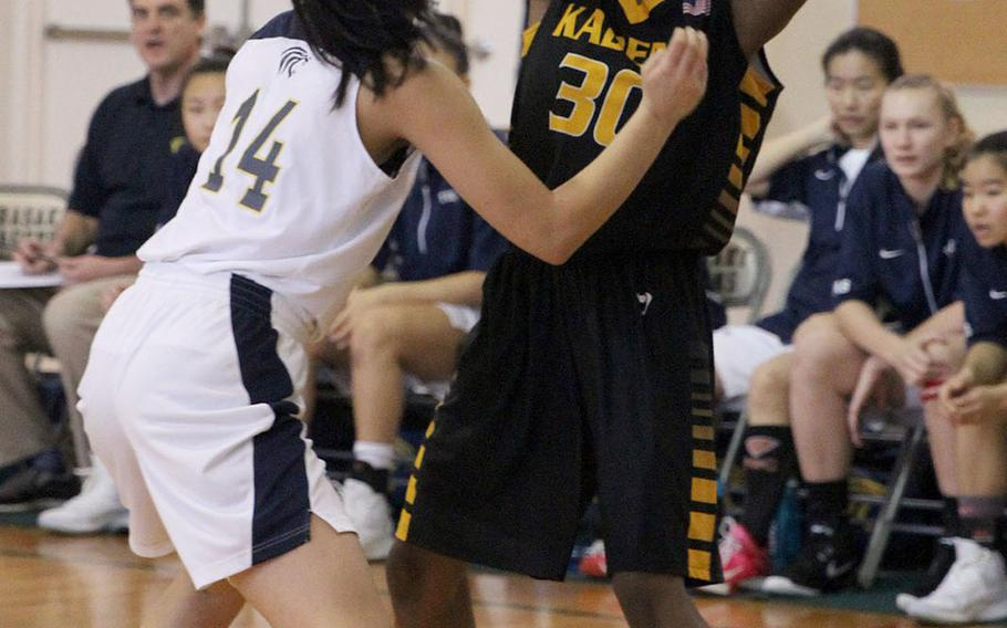 Kadena's Atiria Simms looks to pass against Taipei American during Saturday's Taipei Basketball Exchange girls game. The Tigers downed the Panthers 56-44.