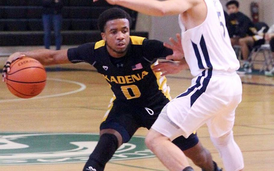 Kadena's Eric McCarter looks for room against Taipei American during Saturday's Taipei Basketball Exchange boys game. The Panthers held on to beat the Tigers 45-39.