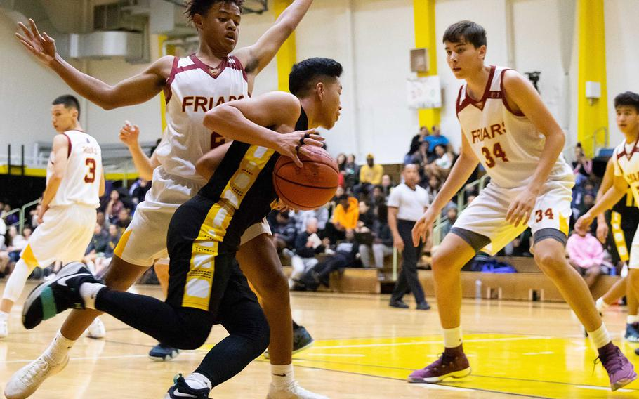 Kadena's Casey Cox tries to drive past Father Duenas' Tony Quinene and Matt Fegurgur during Friday's Kanto Classic boys game, won by the Panthers 48-41.