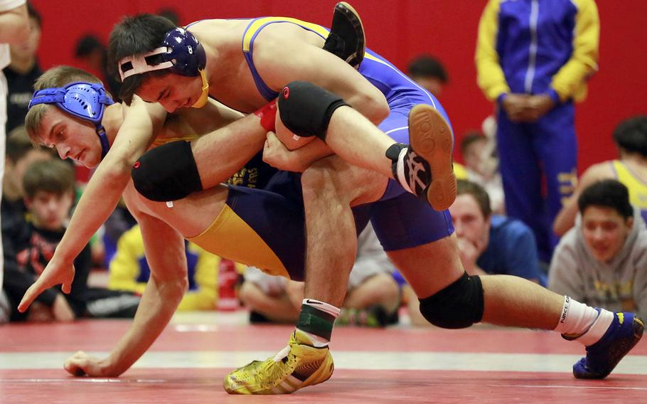 """St. Mary's Austin Koslow gains control of Yokota's Austin Fisher in the 180-pound final of Saturday's Nile C. Kinnick Invitational """"Beast of the Far East"""" wrestling tournament. Koslow pinned Fisher in 59 seconds."""