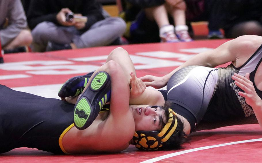"""American School In Japan's Rin Zoot gets a leg lace on Humphreys' Jaiden Workman in the 148-pound final of Saturday's Nile C. Kinnick Invitational """"Beast of the Far East"""" wrestling tournament. Zoot won by technical fall 10-0 in 48 seconds."""