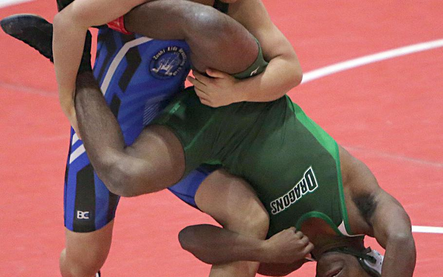 """Shonan Military Academy's Taiga Hirooka turns Kubasaki's Jaylan Mayers upside down in the 122-pound final of Saturday's Nile C. Kinnick Invitational """"Beast of the Far East"""" wrestling tournament. Hirooka won by technical fall 13-2 in 2 minutes, 54 seconds."""