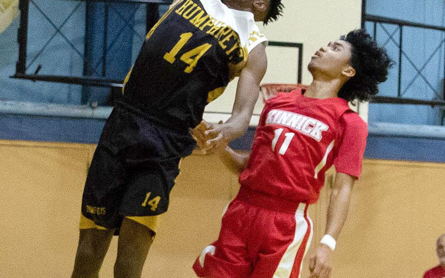 Humphreys' Jalen Hill goes up for a slam dunk against Nile C. Kinnick's Chris Watson.