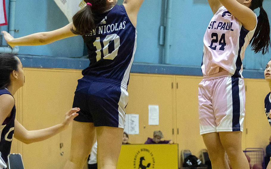 St. Paul Christian's Niah Siguenza shoots against Academy of Our Lady of Guam's Mia San Nicolas.
