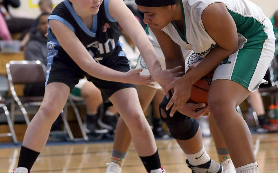 Gimme that ball! Daegu's Katrina Vasquez and Osan's Kennedy Liddell scrum for the ball during Saturday's Korea girls basketball game, won by the Warriors 40-35.