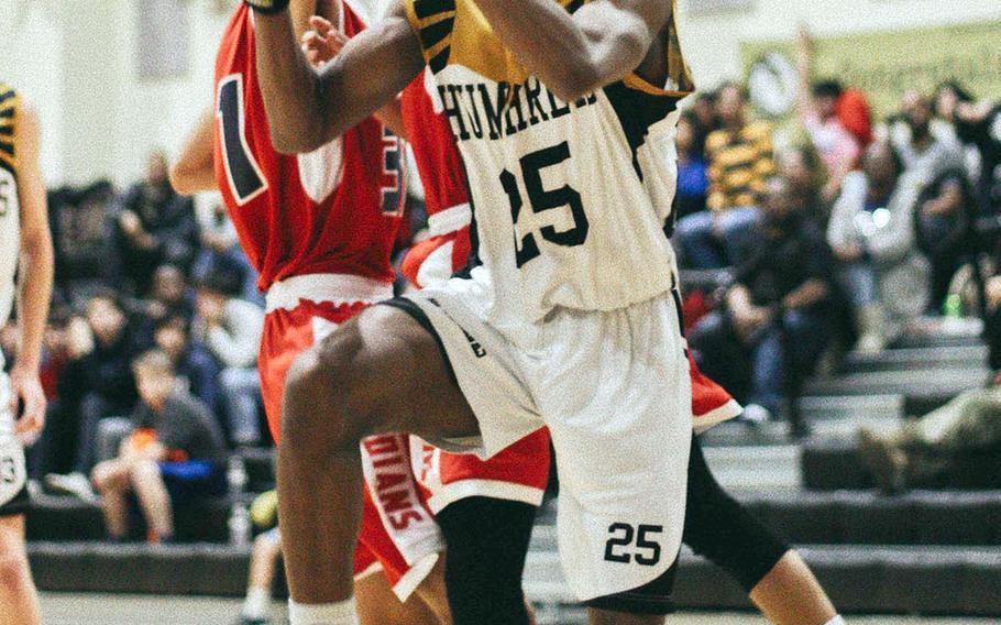 Humphreys' Trevijon Williams drives to the basket against Yongsan International during Wednesday's Korea boys basketball game. The Blackhawks won 70-39.