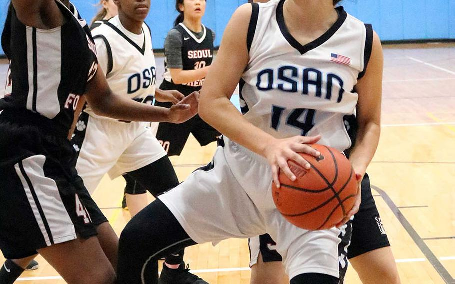 Osan's Maja Inthavixay looks for shooting room against Seoul Foreign during Wednesday's Korea girls basketball game. The Crusaders won 36-33.