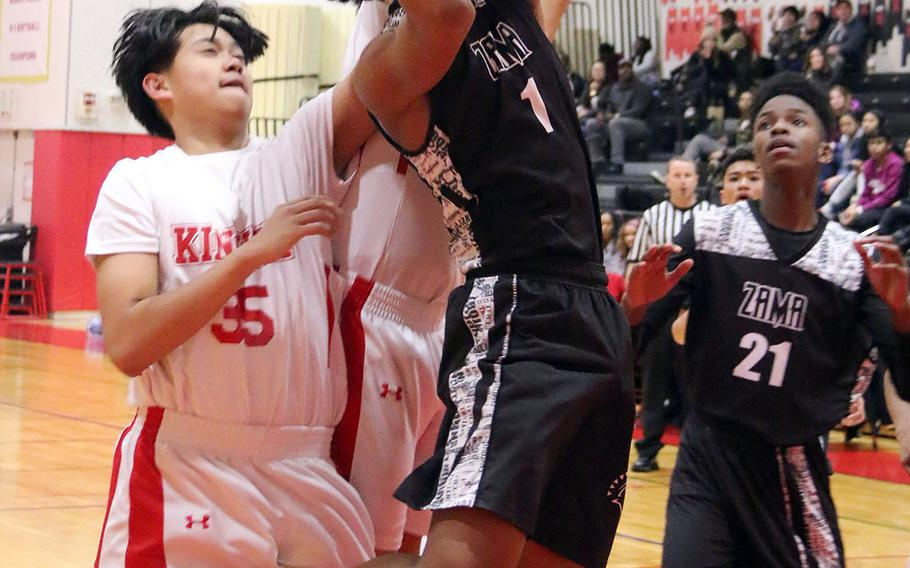 Zama's Keshawn McNeil shoots against Nile C. Kinnick during Tuesday's Japan boys basketball game. The Red Devils won 79-45.