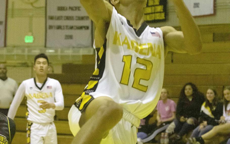 Kadena's Skyler King drives and scores against Kitanakagusuku during Wednesday's Okinawa boys basketball game. The Panthers won 75-62.