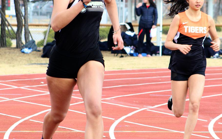 Humphreys senior Ebony Dykes, left, running in the 400, dominated girls field events, taking first place in the shot put, high jump and discus during Saturday's Humphreys Invitational track and field meet.