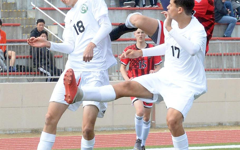 Kubasaki's Joshua Carillo and Alexis Ayala go up to head the ball against Nile C. Kinnick's Kai Sullivan during Friday's Perry Cup boys soccer match at Marine Corps Air Station Iwakuni, Japan. The Red Devils edged the Dragons 2-1. Both teams went on to reach Saturday's semifinals.