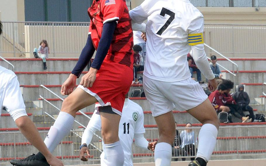 Nile C. Kinnick's Kai Sullivan and Kubasaki's Sinjin Pharathikoune go up to head the ball during Friday's Perry Cup match at Marine Corps Air Station Iwakuni, Japan. The Red Devils edged the Dragons 2-1. Both teams went on to reach Saturday's semifinals.